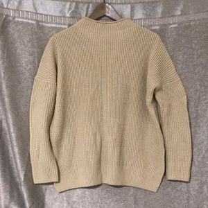 Beige knitted sweater